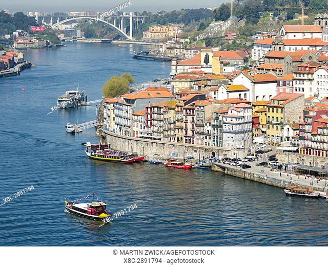 View from Vila Nova de Gaia towards Porto with the old town. City Porto (Oporto) at Rio Douro in the north of Portugal. The old town is listed as UNESCO world...
