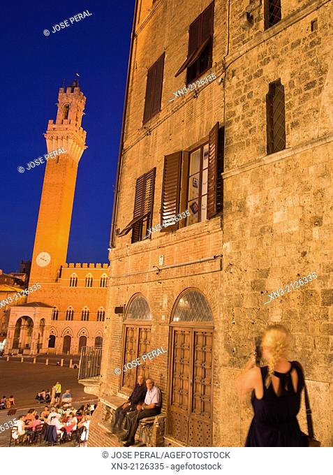 At left Torre del Mangia tower and Palazzo Pubblico town hall, from Costa dei Barbieri, Piazza del Campo, Siena's premier square, Siena