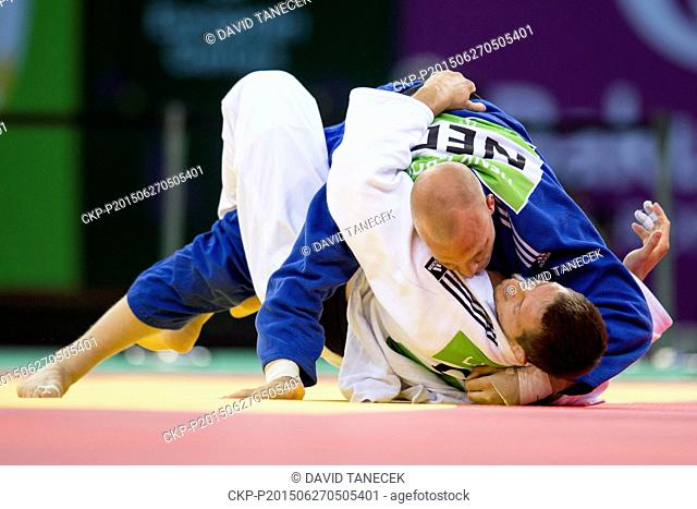 Lukas Krpalek (in white) from Czech Republic and Henk Grol from Netherlands fight during the Men's Judo under 100kg final in Heydar Aliyev Arena at the Baku...