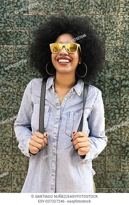 Portrait of beautiful afro american woman in the street