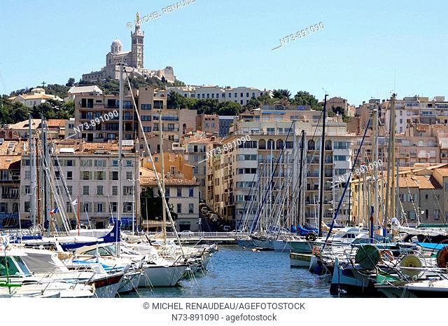 Vieux-Port and basilica of Notre-Dame de la Garde in background, Marseille, Bouches-du-Rhône, France