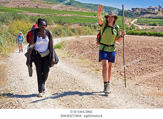 two pilgrims on the way from Cirauqui to Estella, Spain, Basque country, Navarra