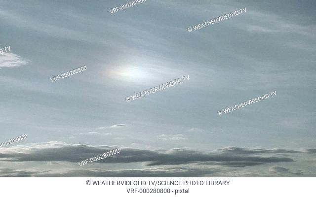 Timelapse footage of a sundog, or parhelion, setting through cirrus clouds. Sundogs are formed by the refraction of sunlight through countless tiny ice crystals...