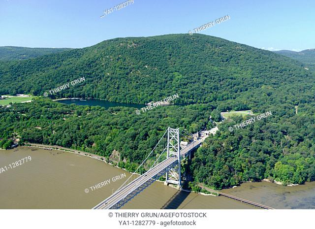 Aerial view of Hudson riverbank and Bear mountain bridge, Hessian lake, and back Bear Mountain state park during summertime, south of Fort Montgomery town