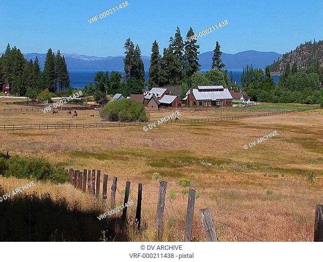 A farm in Lake Tahoe sits near a lake in the Sierra Nevada mountains