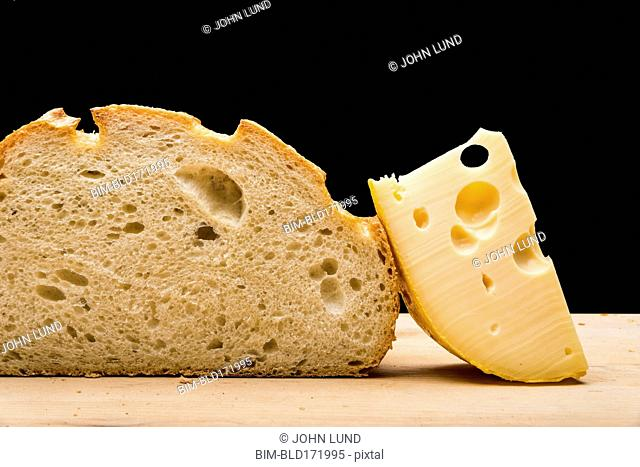 Close up of cheese slice and bread on cutting board