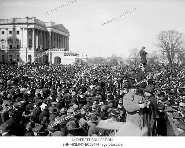 Crowds at the inauguration of President Warren Harding, March 4, 1921. Pressmen use ladders to photograph over the heads of the spectators on the east side of...