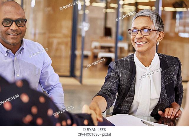 Businesswomen handshaking in meeting