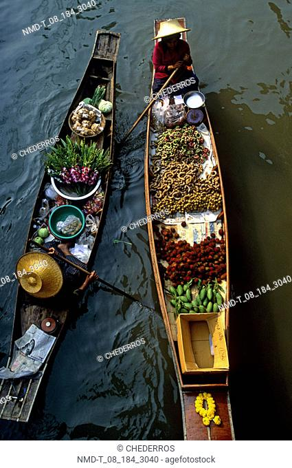 High angle view of two vendors in a floating market, Thailand