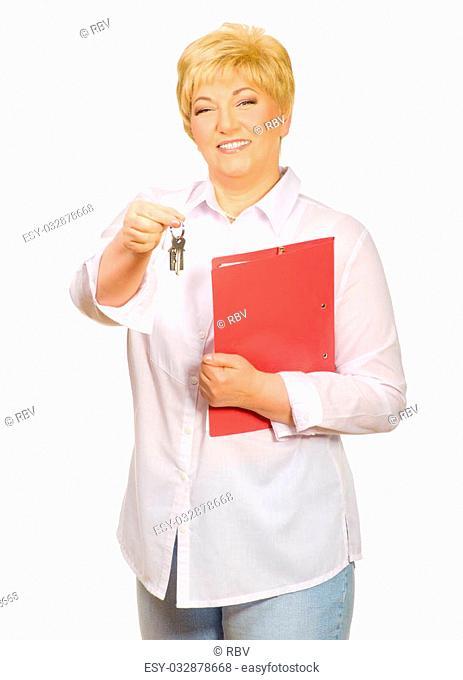 Happy senior woman with keys isolated