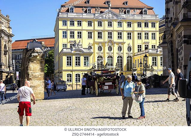 Asian tourists in front of the Cosel Palace near Frauenkirche Church in the city of Dresen, Saxony, Germany