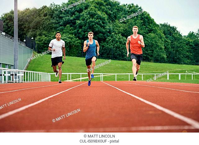 Runners training on running track