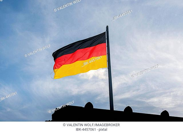 German flag in front of blue sky, Reichstag, Berlin, Germany