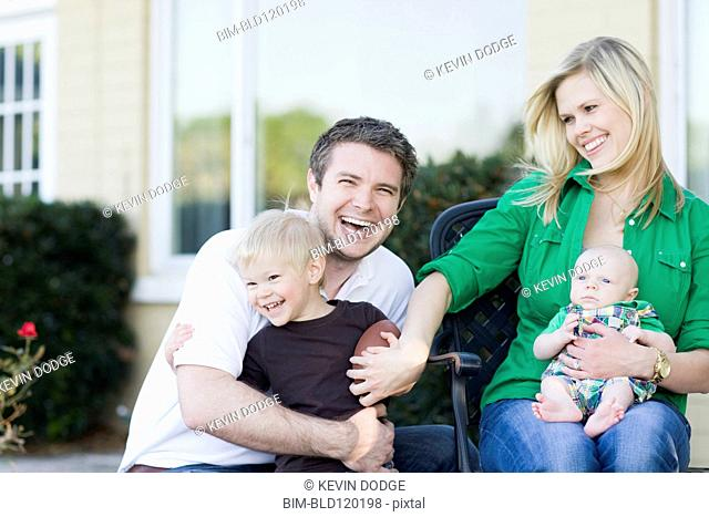 Caucasian family relaxing outdoors