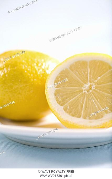lemon and half lemon on plate