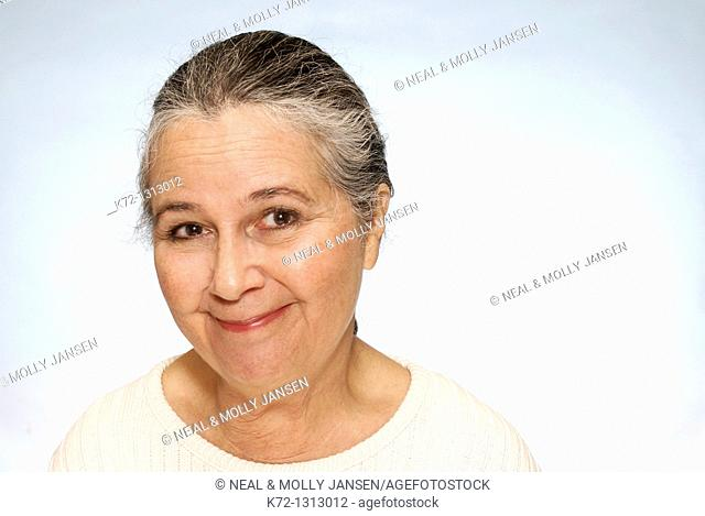 Portrait of older woman grinning