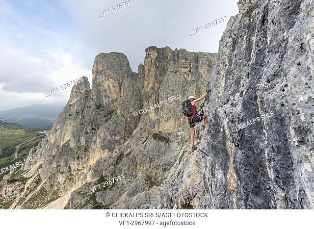 Col dei Bos, Cortina d'Ampezzo, province of Belluno, Veneto, Italy. Climber on the via ferrata degli Alpini