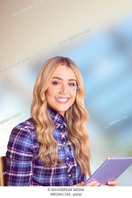 Female hipster holding digital tablet over blur background