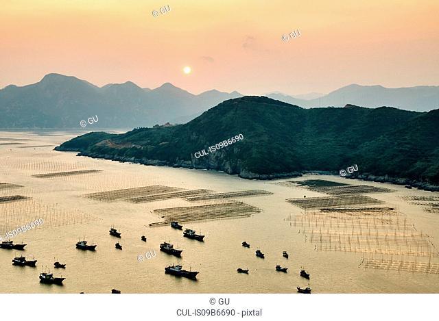 Traditional fishing boats at sunrise, Huazhu, Fujian, China