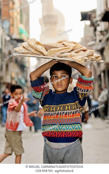 worker child on egypcian market