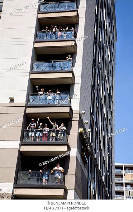 People on Balconies Waving at the Gay Pride Parade in Toronto, Ontario