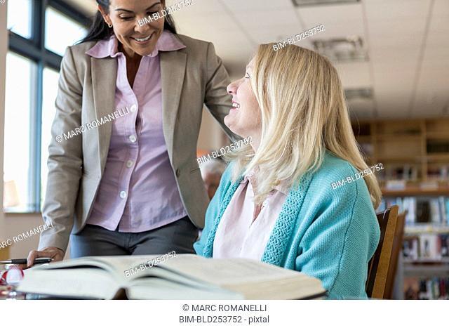 Older women talking in library