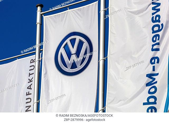 VW logo on the flag in front of Glaeserne Manufaktur, Transparent Factory, Volkswagen Factory, Car Production, Dresden, Saxony, Germany, Europe