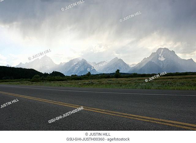 Road with Teton Mountain Range in Background, Grand Teton National Park, Wyoming, USA