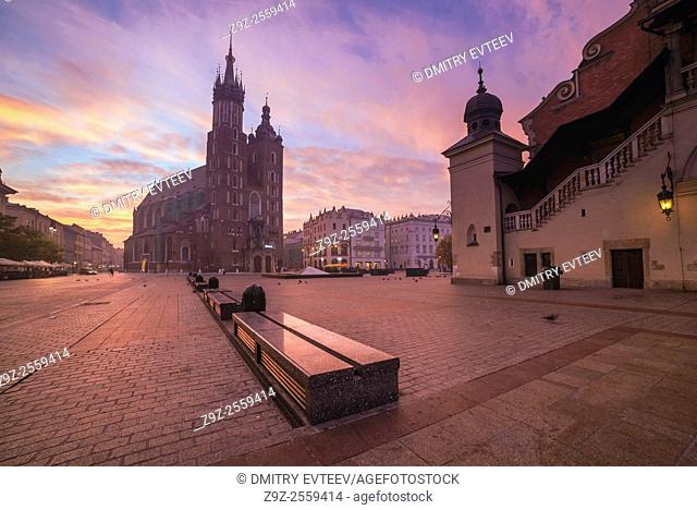 Krakow, Poland. The Cloth Hall and Mariacki Church on market square, perspective view of building's walls. Image is taken in sunrise time