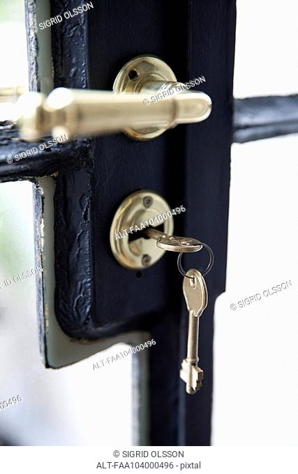 Key in door lock, close-up