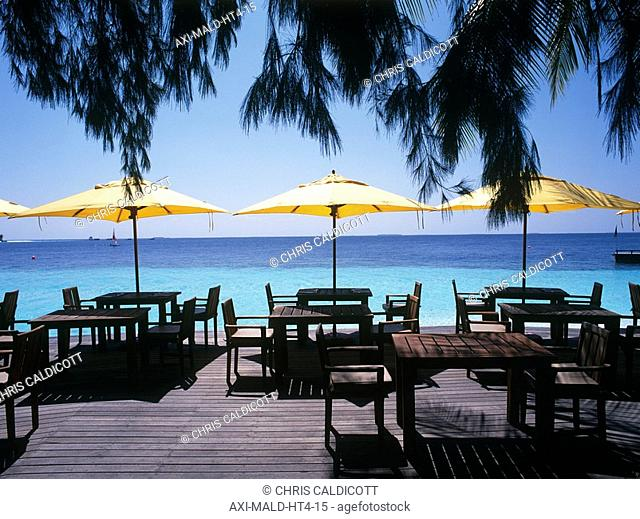 Deck chairs, tables and umbrellas on beach