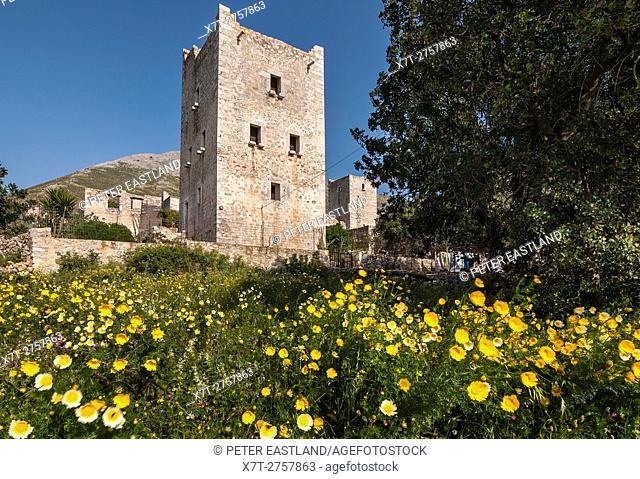 Stone tower house and wild flowers in the village of Kita, in the Deep Mani, Southern peloponnese, Greece