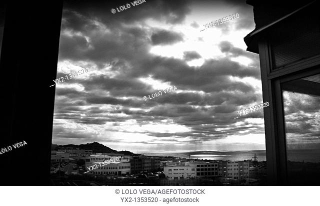 Cloudy sunrise from a balcony, Mataro, Barcelona province, Catalonia, Spain