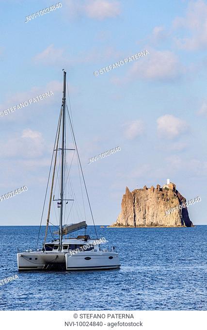 The Strombolicchio, rocky island ahead of volcanic island of Stromboli, Aeolian Islands, Sicily, Italy