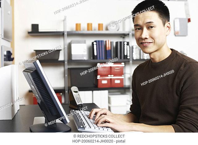 Portrait of a businessman using a computer
