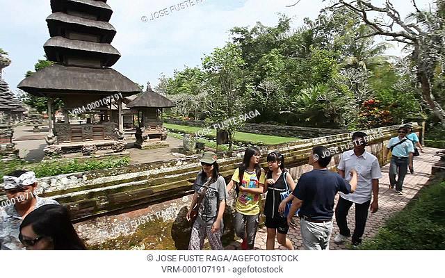 Indonesia, Bali Island, Mengwi City, Pura Taman Ayun Temple,colecting flowers