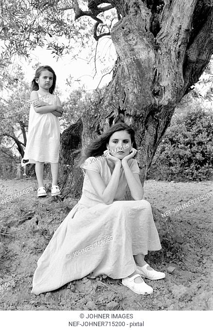 Girl with her mother by a tree, Spain