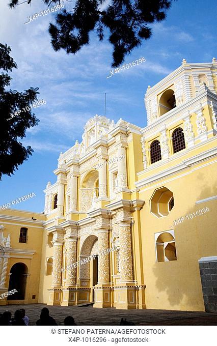 Iglesia La Merced Church with its white and yellow facade in Antigua Guatemala