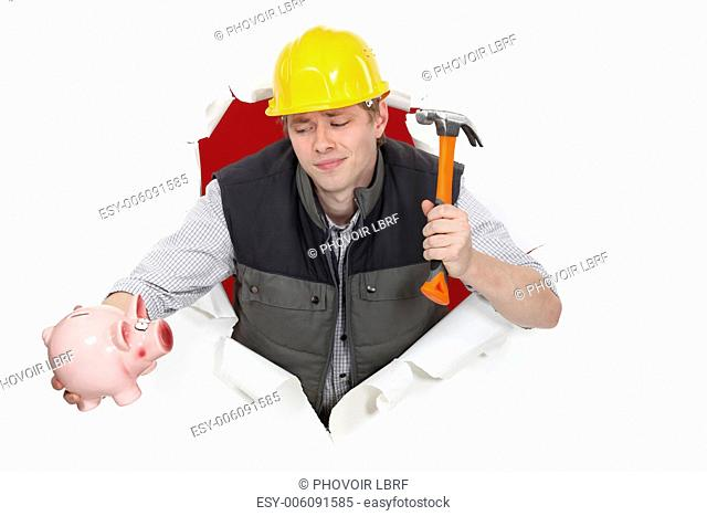 Construction worker with a hammer and piggy bank