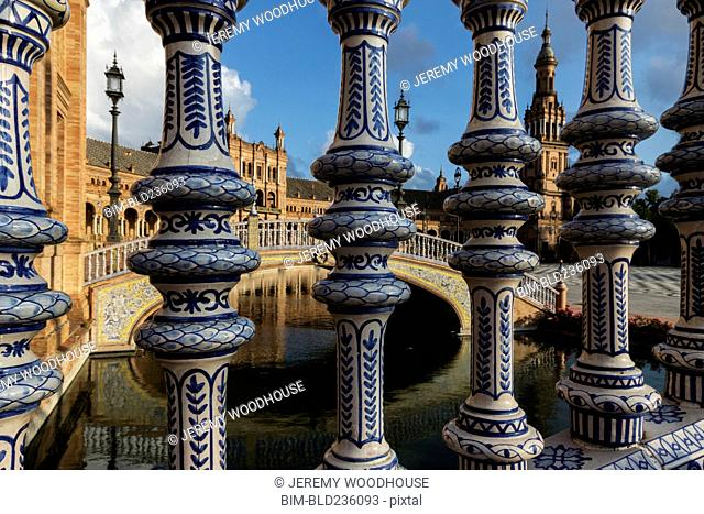 Ornate pillars at canal, Seville, Andalucia, Spain