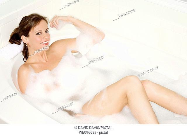 Beautiful Caucasian woman enjoying a nice bubble bath