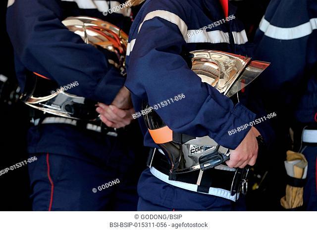 Firefighter and helmet