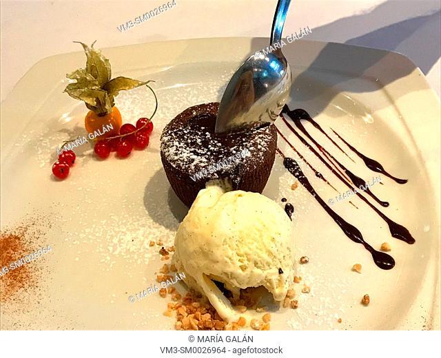 Eating chocolate cake with ice cream