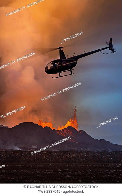 Helicopter flying over the volcano eruption at the Holuhruan Fissure, near the Bardarbunga Volcano, Iceland