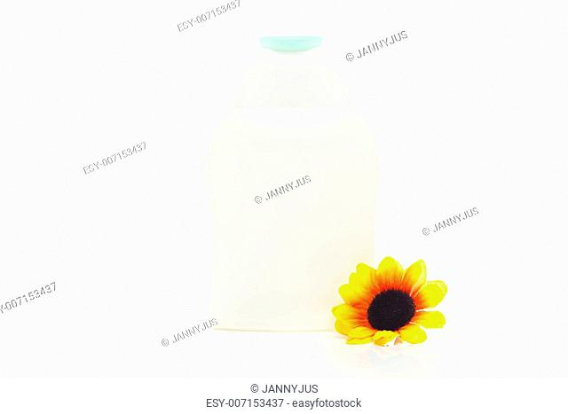 cosmetic containers and flower isolated on white