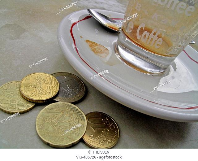 empty cup glas of espresso expresso with coins on table. - 03/04/2007