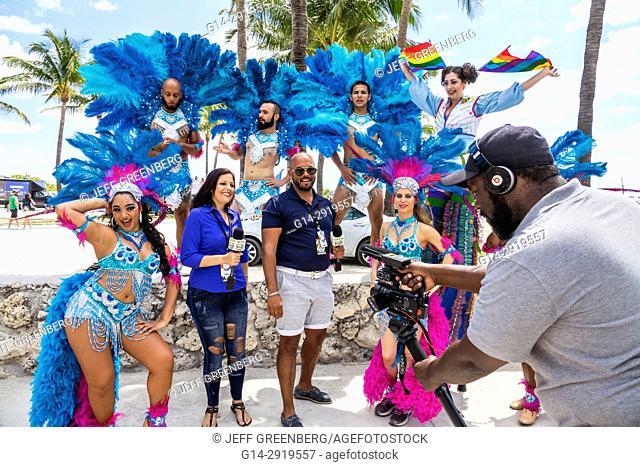 Florida, Miami Beach, Lummus Park, Gay Pride Week, LGBTQ, LGBT, Pride Parade, participants, staging area, Hispanic, media, tv television, reporter, microphone