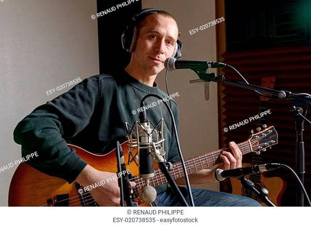 guitarist in a recording studio