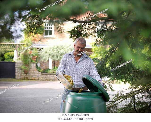 Man composting food scraps