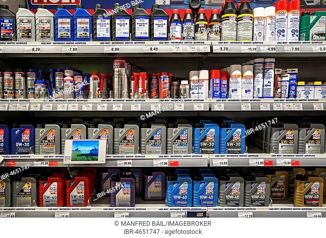 Shelf with engine oil, car care products, hardware store, interior, Bavaria, Germany